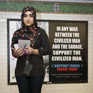 Muslim woman In what looks like a warning
